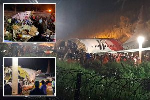 Air India plane crash leaves 14 dead & 4 trapped in wreckage after jet overshoots runway and breaks apart in Calicut