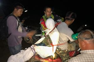 Bizarre moment medics strap dead woman to motorbike to take body to morgue in Thailand