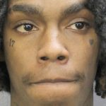 Who is YNW Melly and what crimes is he accused of committing?